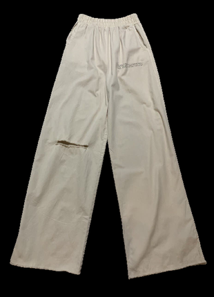 Широкие трикотажные брюки  с эластичной талией2 фото
