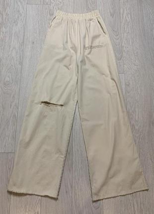 Широкие трикотажные брюки  с эластичной талией3 фото