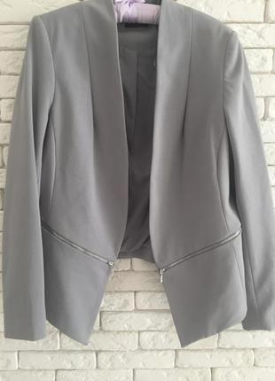 Стильный пиджак с замочками