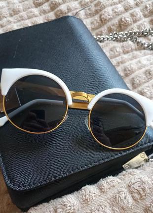 Сонцезахисні окуляри котяче око, солнцезащитные очки кошачий глаз