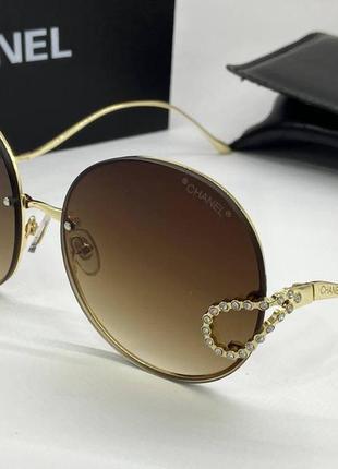 Chanel очки женские солнцезащитные коричневые кругляшки с фигурными дужками