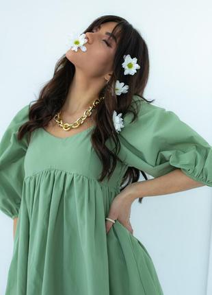 Однотонное платье с расклешенным низом2 фото