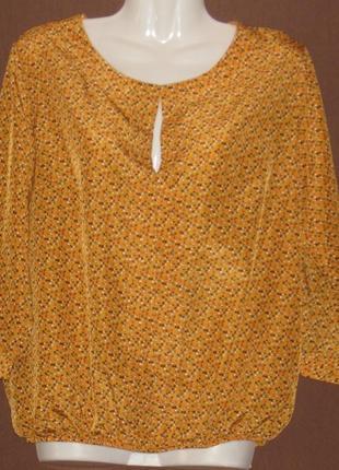 Блузка женская оранжевая. с длинным рукавом. снизу на резинке. 46 р-р