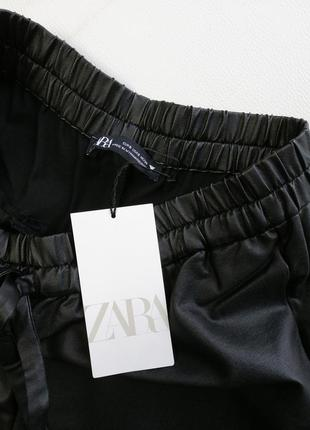 Трендовые широкие брюки палаццо трубы с ващеным покрытием8 фото
