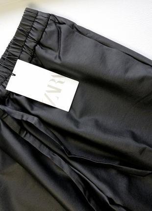 Трендовые широкие брюки палаццо трубы с ващеным покрытием7 фото