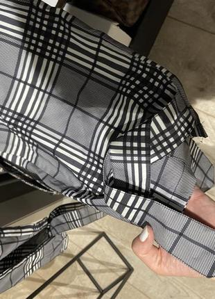 Крутые лёгкие свободные брюки джоггеры в клетку на завязках и резинкой7 фото