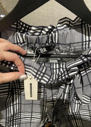 Крутые лёгкие свободные брюки джоггеры в клетку на завязках и резинкой9 фото