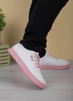 Жіночі білі кросівки з рожевою підошвою