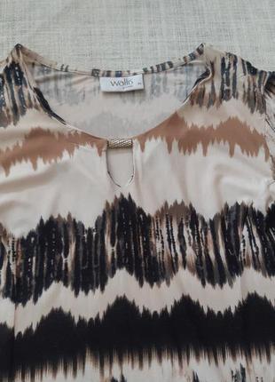 Сукня з оригінальним принтом4 фото