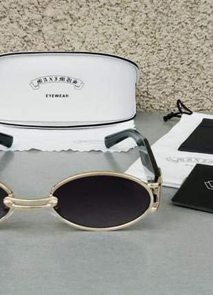 Модные трендовые солнцезащитные очки унисекс узкие овальные черные в золоте