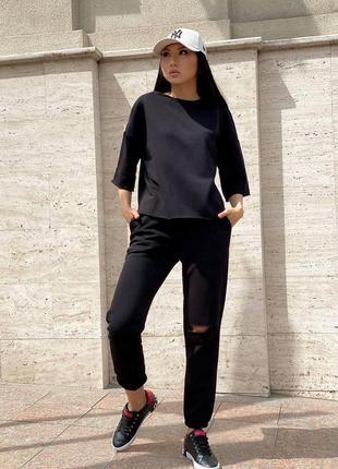 Спортивный костюм футболка и штаны с разрезом черный5 фото