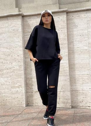 Спортивный костюм футболка и штаны с разрезом черный3 фото