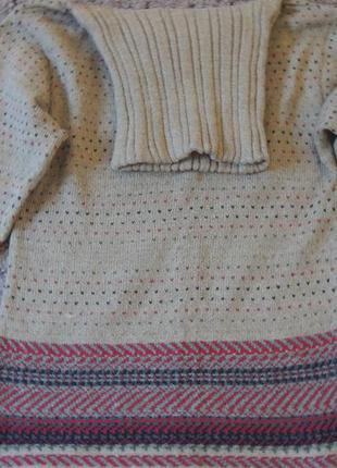 Шерстяной свитер с высокой горловиной