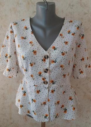 Актуальная укороченая блузка на пуговицах в цветочный принт2 фото