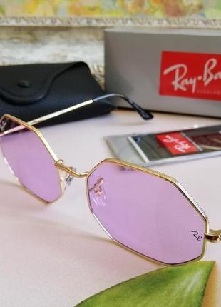 Стильные овальные солнцезащитные женские очки в металлической оправе с  лиловой линзой