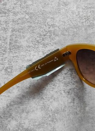 Новые очки солнцезащитные в цветной оправе6 фото