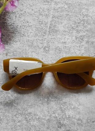 Новые очки солнцезащитные в цветной оправе5 фото