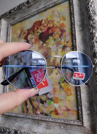 Солнцезащитные округлые очки унисекс в металлической оправе с голубой линзой