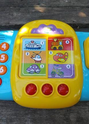 Музыкальная игрушка с телефоном.детский игрушечный телефон