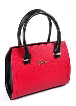 Красная небольшая каркасная сумочка саквояж с черными боками