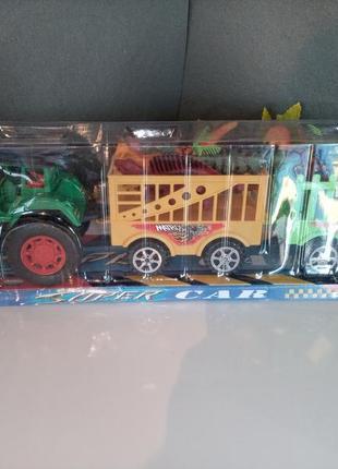 Трактор с прицепом и динозаврами