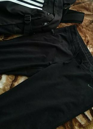 Фирменные женские спортивные штаны.