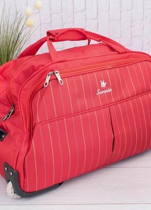 Красная дорожная сумка