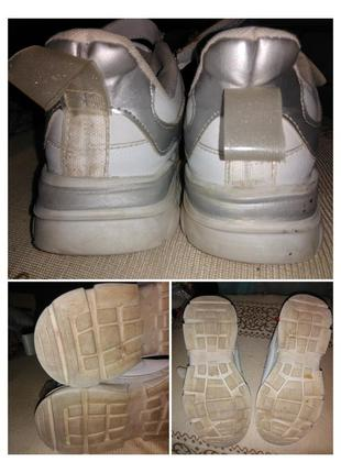 Кроссовки белые со светоотражающими полосками.3 фото