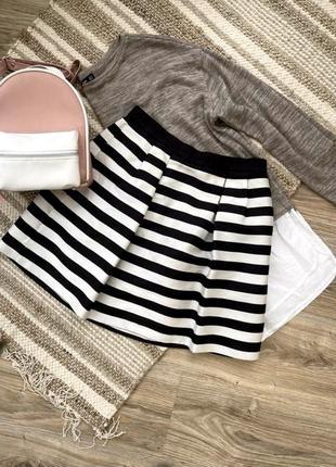 Короткая юбка с карманами