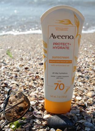 Солнцезащитный лосьон крем  «защита+гидрат» от aveeno с широким спектром spf 70