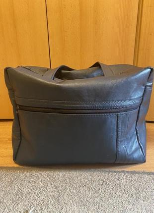 Дорожная кожаная сумка ручной работы