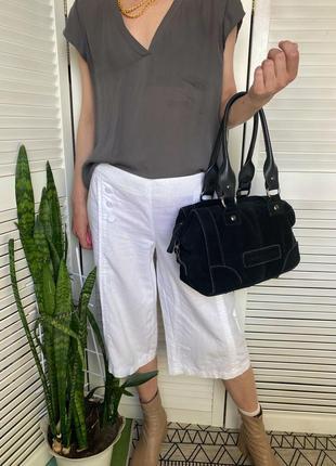 Замшевая сумка багет чёрного цвета janet sport. италия