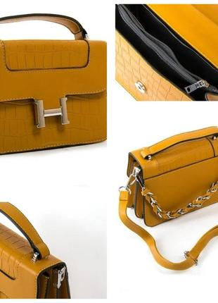 Яркая жёлтая аккуратная сумка клатч,