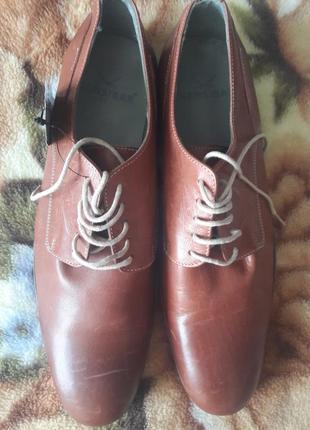 Новые кожанные туфли.