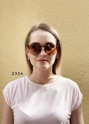 Коричневые очки без оправы лето 20213 фото