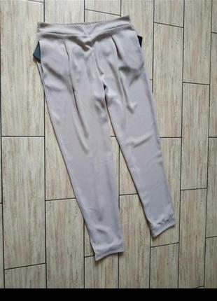 Нюдовые штаны с боковыми карманами