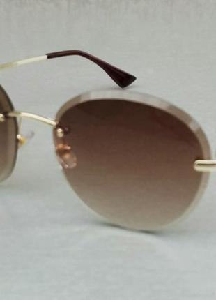 Salvatore ferragamo очки женские солнцезащитные круглые безоправные коричневые с градиентом