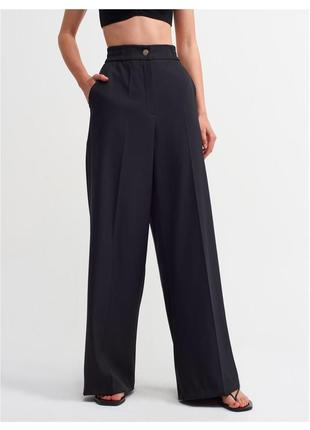 Чорні брюки кльош, чёрные штаны клёш dilvin