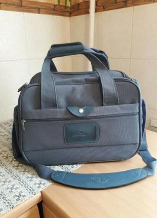 Добротная брендовая дорожная сумка чемодан