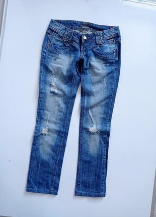 Синие рваные джинсы на низкий рост1 фото