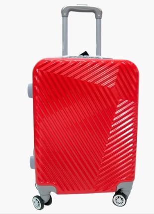Яркий маленький чемодан из поликарбоната, италия