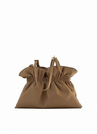 Бежевая сумка мешок со сборкой