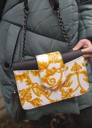 Яркая сумочка клатч