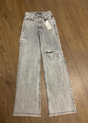 Джинсы широкие со рваностями, джинсы с разрезами, джинсы палаццо, широкі джинси