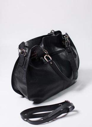 Большая и вместительная сумка из кожи.1 фото