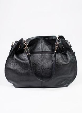 Большая и вместительная сумка из кожи.2 фото