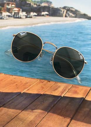 Солнцещащитные очки ray ban раунды2 фото
