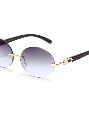 Стильные овальные солнцезащитные очки безоправные 2021 года1 фото