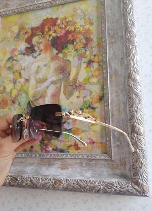 Эксклюзивные безоправные солнцезащитные очки с гепардами на дужке