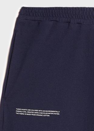 Оригінальні шорти pangaia organic apc cotton pique shorts acne ami2 фото